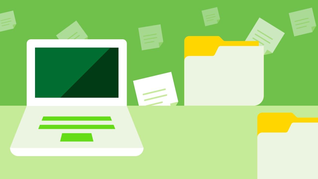 Komputer i dokumenty na zielonym tle