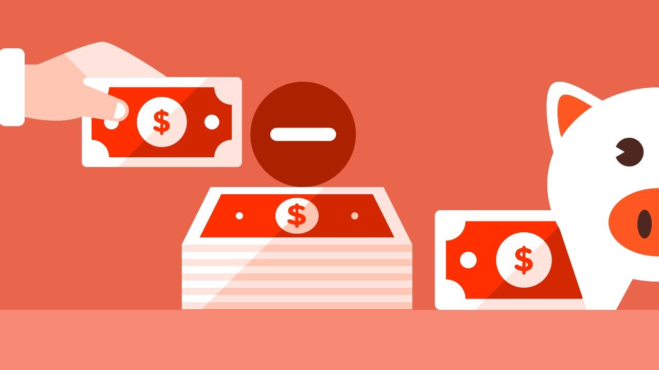 Czerwone banknoty i świnka skarbonka
